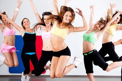 Enthusiastic group of women having fun during aerobics class.
